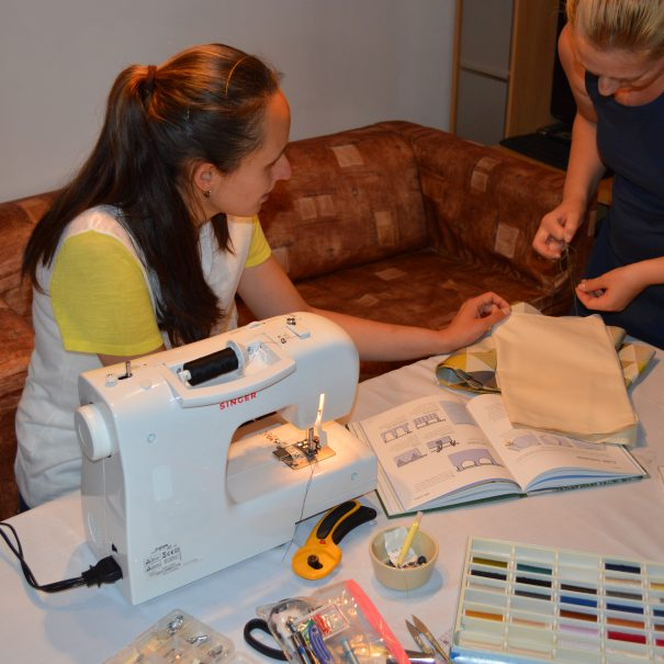 The sewing tutor teaching her student