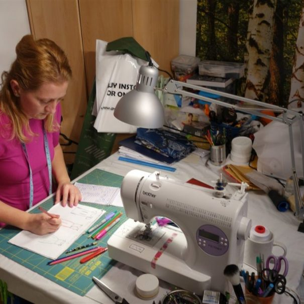 Dressmaker sketching a set of outfits for a client