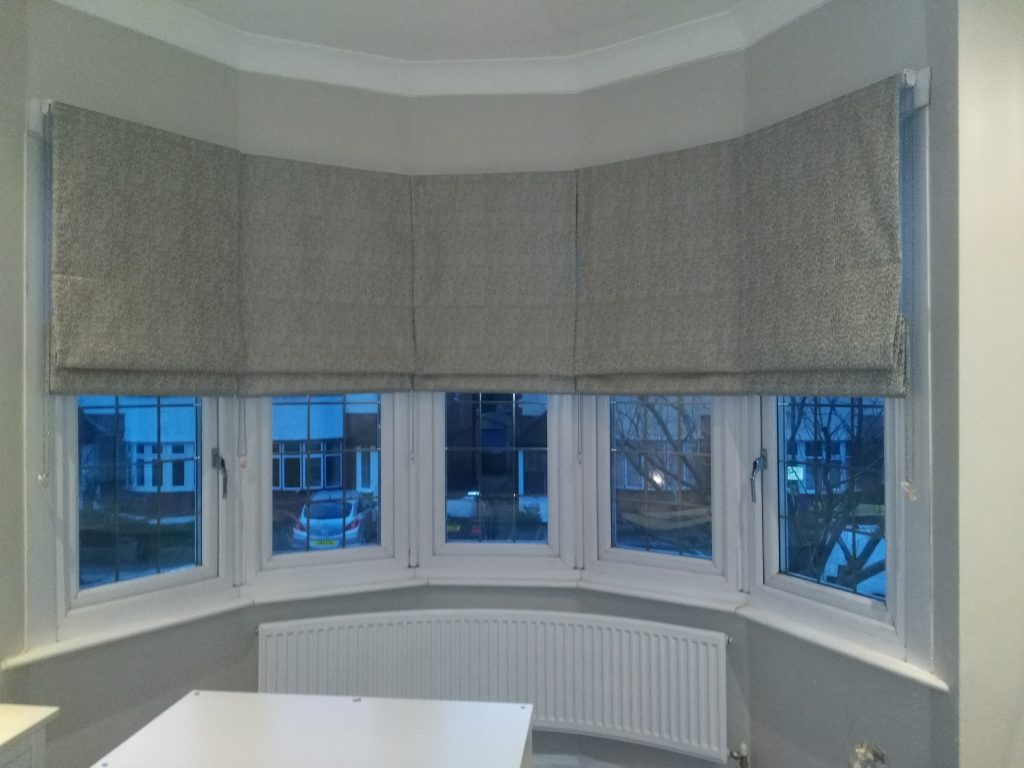 A set of five made to measure roman blinds